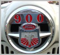 The hundred series tractors carried a front hood emblem identifying them by series number.