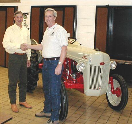 The winning bidder and new 8N owner Steve Schmidgall of Peoria, IL (left).